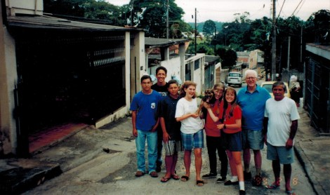 Dad with our girls and neighbors in Brazil